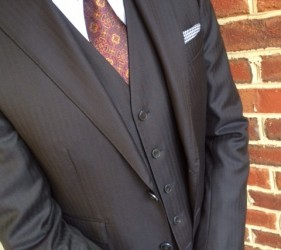 Custom navy three-piece suit by Jmac's Clothiers.