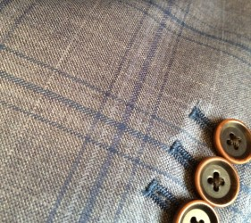 Gray and blue sport coat by Reda; working button holes